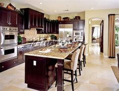 Dark wood kitchen with light tile floor