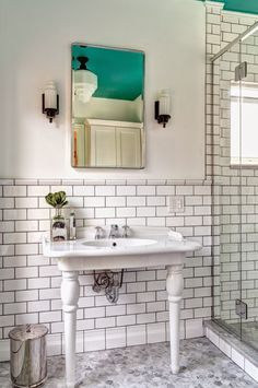 White and tile on the walls, blue on the ceiling!