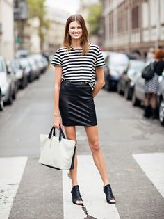 Nothing to wear? Try this trusty tip: pair a slouchy striped tee with your leather mini skirt for an occasion outfit! Tuck in the front of the shirt for unstudied flair find more women fashion ideas on www.misspool.com