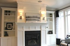 LOOOOVE This Fireplace surround mantel and wainscotting with built-ins. YES PLEASE!