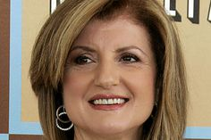 Ariana Huffington in double hoops.