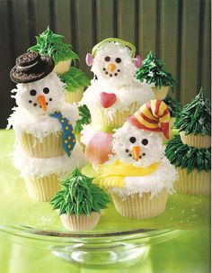 Snowmen made of stacked cupcakes and embellishments for Christmas
