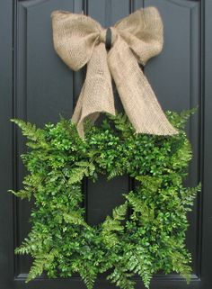 Boxwood, fern and burlap in square wreaths...