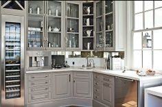 Fabulous tricked out butlers pantry with wine refrigerator, bar sink, espresso machine, and mini dishwasher.