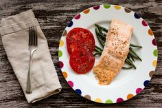 Homemade orange chili oil with roasted salmon and green beans