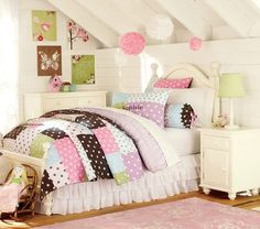 love the ceilings, and the walls, and the walls hangings and the bed skirt. definitely the type of room I want for my girls - just with a different bedspread