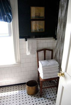 white tile and dark walls. love the vintage mix or furniture/art.