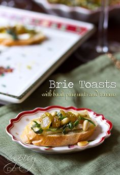 Brie Toasts with Basil Pine Nuts and Golden Raisins #appetizer #holiday #christmas