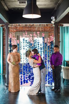 paper ceremony backdrop, photo by Izzy Hudgins Photography http://ruffledblog.com/bohemian-diy-inspiration-shoot #weddingideas #backdrops