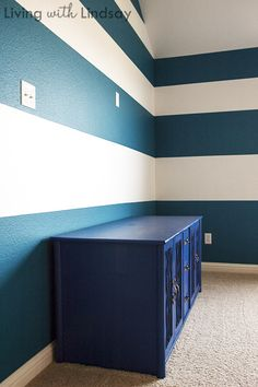 Painting stripes on a wall or two is a cheap way to create some drama in a room. Tone on tone color gives a classic feel to a room while contrasting colors provide bold visual interest. Regardless of your color choices, there are two vital elements to pulling off a perfectly striped room: 1) level stripes and 2) crisp paint lines. Today, I'm going to help you learn to do both. Yeehaw!