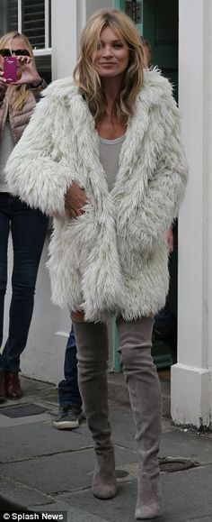 Kate Moss #boots  hello, did you not notice the gorgeous faux fur coat?