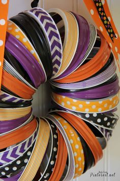 Halloween Wreath - Make this darling Halloween wreath with mason jar rings and washi tape. #Halloween #Craft #DIY