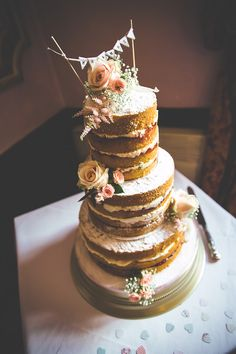 Stunning naked wedding cake nake cake, vintage weddings, rustic look, red roses, rustic weddings, rustic wedding cakes, flower, banner, cake toppers