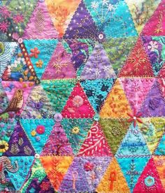 """Fantastic """"crazy quilt hand embroidery"""" on a triangle quilt 