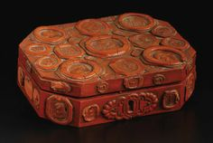 A souvenir of the Grand Tour, the rectangular red painted box with canted corners applied all over the form and on the interior cover with intaglio seal impressions in resin  2.38 inches high x 8.38 inches wide x 6.5 inches deep