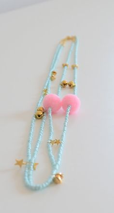 Blue necklace and pink pompom for the little ladies by Twiggy and Lou