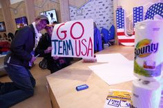 Families of Olympians make signs to prepare to cheer on #TeamUSA in the #PGFamily home in #Sochi.