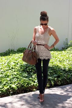 Crochet top, jeans and brown leather bag. The bun on the top of the head is the cherry on top.