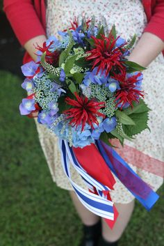A red, white, and blue bouquet. Red monarda, blue hydrangea, white gooseneck, and blue lacecap hydrangea.