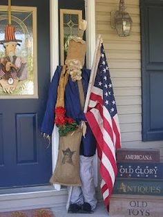 Uncle Sam scarecrow? Make the head, use 2 x 4's for the body. Add red blue or white clothess. Use flag on pole. Add a burlap bag. Sam's hair could be an old mop or cut strips of cloth.