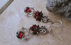 red crystal earrings  in sterling silver by EdisLittleTreasures, $62.00  https://www.etsy.com/listing/129320374/red-crystal-earrings-in-sterling-silver?ref=v1_other_2