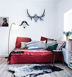 bed and pillows. bohemian light