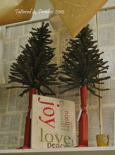 Christmas trees on tall spindles, old table legs
