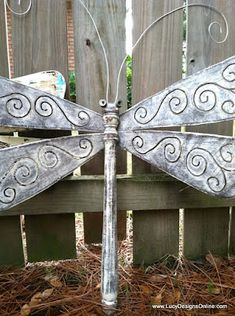 Dragonfly made from table leg & wings made from fan blades.