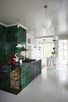 I love the little storage area for firewood, and the vibrant green combined with the white