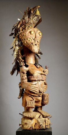 Ethnic group : Songye  Country of origin : Zaire ( D.R. Congo )  Material : Wood, metal, bell, cloth, rope, feathers, horns, animal skin, unknown substances  Approximate age :  Early – Mid 20th Century