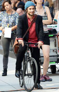 Gael Garcia Bernal rides a bike as he shoots the TV pilot Mozart in the Jungle in Manhattan