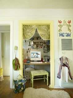 Turn a closet into a small office. Remove the door and put a valence in the door-frame to help divide the space.