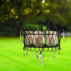 wire basket with mason jars and candles becomes an outdoor chandelier.