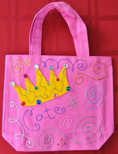Goodie bags for the girls.  Got the bag at a craft store then added felt crown, rhinestones and fabric paint.