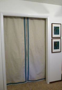 dropcloth closet doors w/ a painted border--the boys need something different over their closet