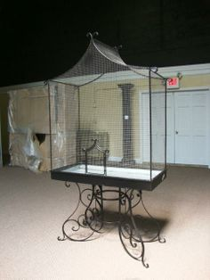 WROUGHT IRON BIRDCAGE ON STAND