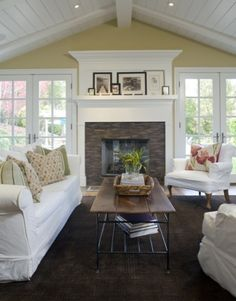 Fireplace ~ stone with painted wood mantel, windows flanking fireplace