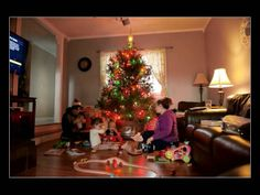 How To Photograph Your Christmas Morning. Learn how photographer Melissa Stottmann photographs Christmas morning without being tied behind t...