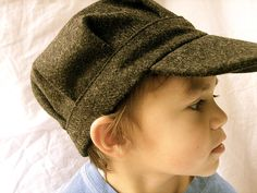 I absolutely have to make one of these for both my boys.....when I have money Im gonna try and find some fabric that will look awesome!  They love hats!