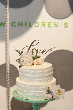"""love"" cake topper, photo by SheWanders http://ruffledblog.com/modern-new-childrens-museum-wedding #weddingideas #cakes #weddingcake"