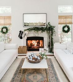 Beautiful neutral holiday decor Designed by Anastasia Casey of  The Identité Collective .  Farmhouse Living Rooms  Farmhouse Winter