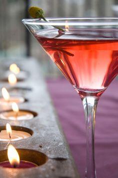 Tootsie Pop Rock Martini with Amaretto, White Creme de Cacao, Vodka, Cranberry-Pomegranate Juice, & Szechuan Buttons