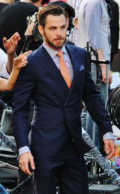 Navy double breasted suit, orange tie