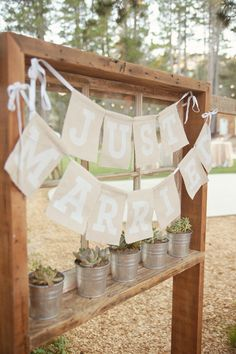 """Just Married"" bunting, photo by Emily Heizer http://ruffledblog.com/woodsy-sierra-nevada-wedding #bunting #signs #justmarried"