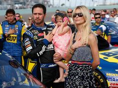 Jimmie Johnson, his daughter Genevieve Marie, and wife Chandra stand for the national anthem prior to the Ford EcoBoost 400 at Homestead-Miami Speedway