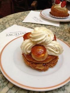 Angelina in Paris has this wonderful Saint Honore. It is puff pastry, caramel-coated pate a choux, soft caramel, whipped Bourbon vanilla cream
