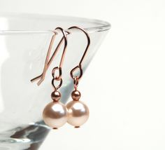 Small Minimalist Cream Pearl and Rose Gold Earrings  by lilicharms, $15.00