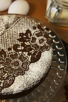Use lace over a chocolate cake...then sprinkle with powered sugar...then carefully remove lace. so smart, and pretty! this could be super cute for a country wedding