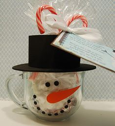 Snowman Soup with Printable Poem Tag - wrap some small marshmallows, a couple packages of hot chocolate, and some peppermint kisses in a cello bag, tie in two candy canes with a bow!!