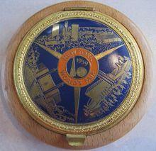 1939 New York World's Fair enamel and wood compact